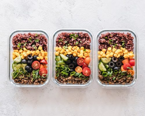 3 containers with healthy meal preps. Healthy eating is crucial for creating a calorie deficit.