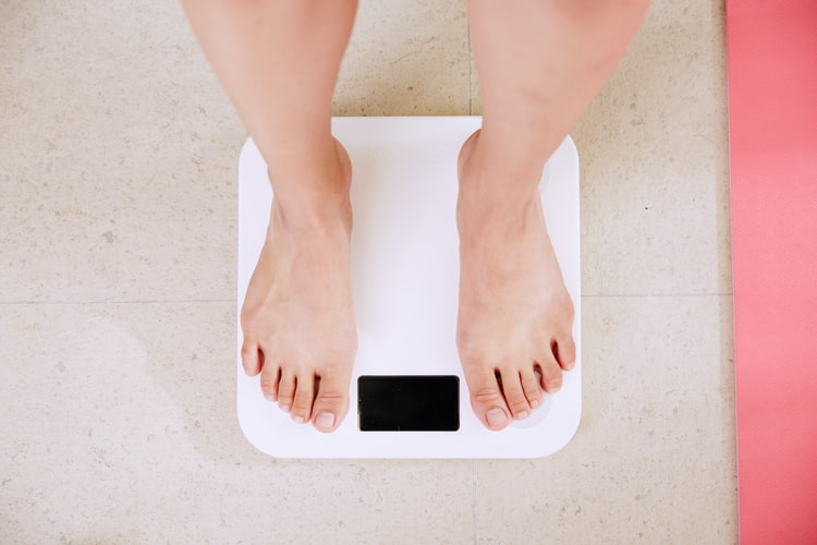 Someone standing on the bathroom scales. There are many ways to measure success that don't depend on the scales.