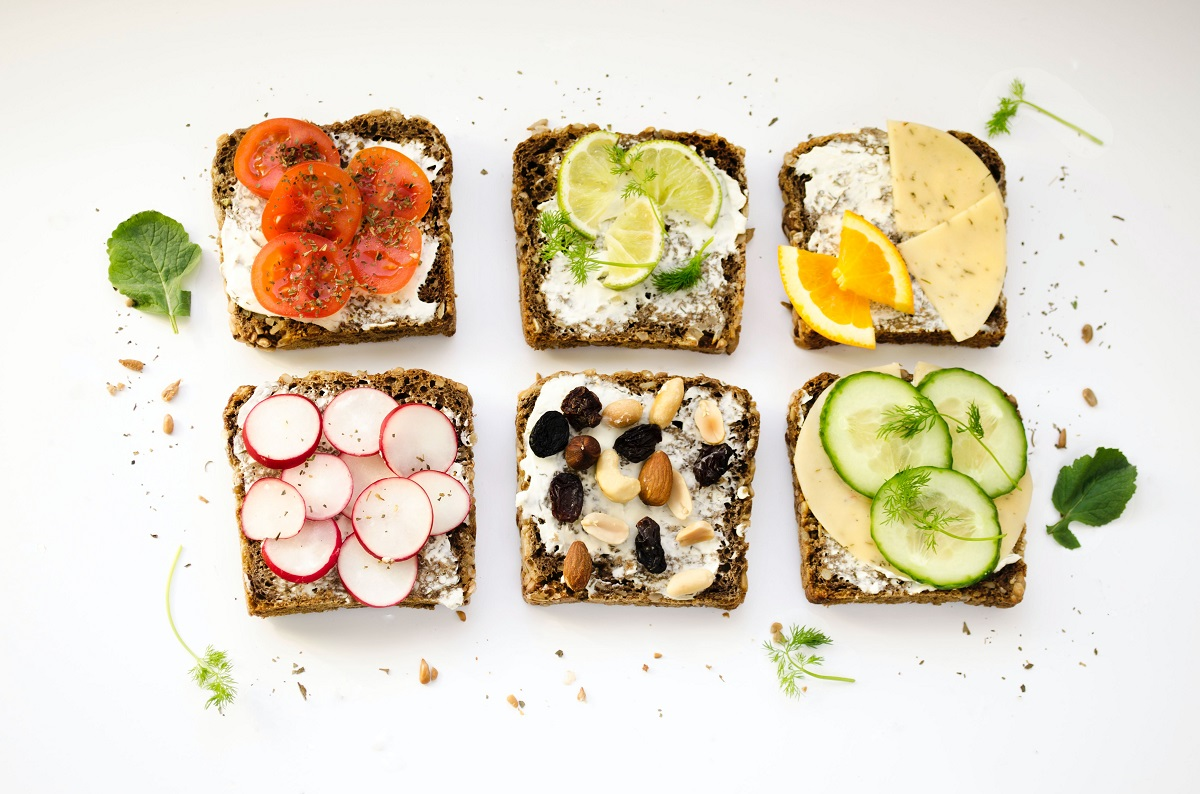An array of bread slices with different healthy toppings