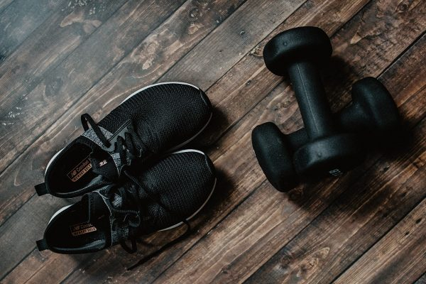 Gym trainers and dumbbells